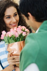 Young Woman Receiving Gift of Roses